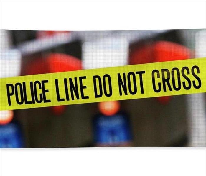 """POLICE LINE DO NOT CROSS"" tape at a crime scene."